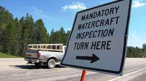 Why Paddleboards, Kayaks, And Canoes Also Have To Stop At Boat Check  Stations | MTPR